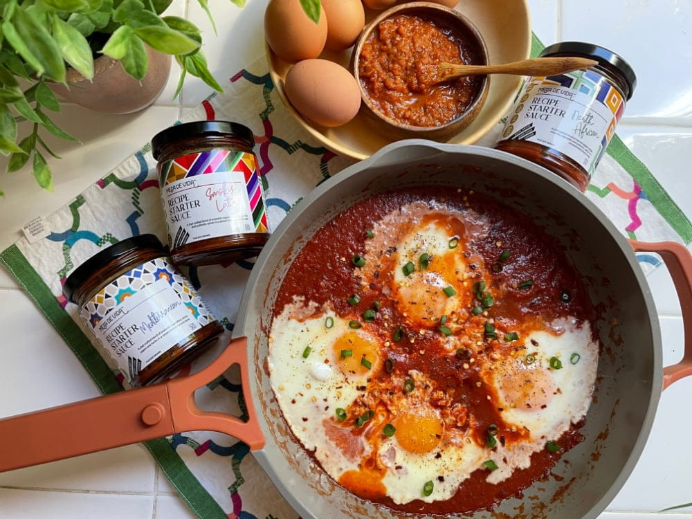 Eggs in a savory tomato sauce with flavors from around the globe